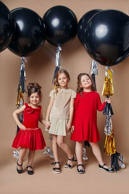 Stylish kids in evening dresses celebrating Premium Photo