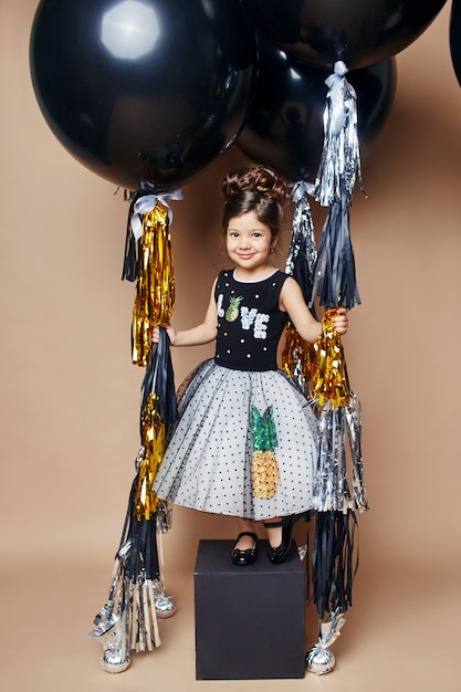 Stylish kids in evening dresses and costumes celebrating the first day of school Premium Photo