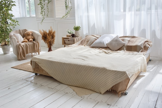 Stylish loft cozy bedroom with double bed, armchair Premium Photo