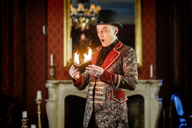 Stylish magician shows focus with fire Premium Photo