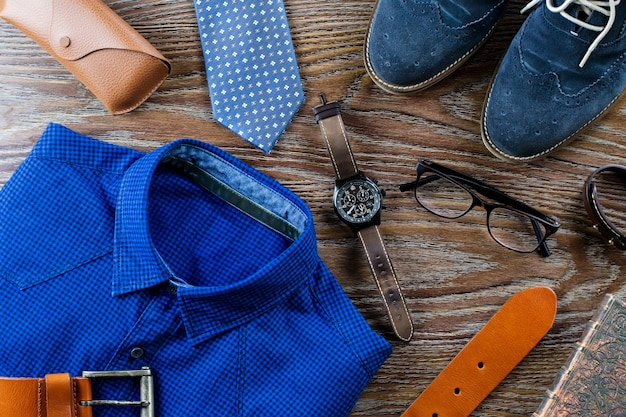 2020 stylish-man-clothing-accessories-flat-lay-blue-brown-colors-wooden-table_151851-749.jpg