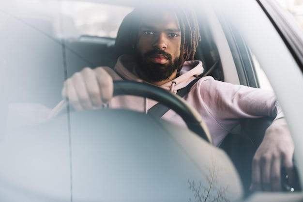 Stylish man driving front view Free Photo