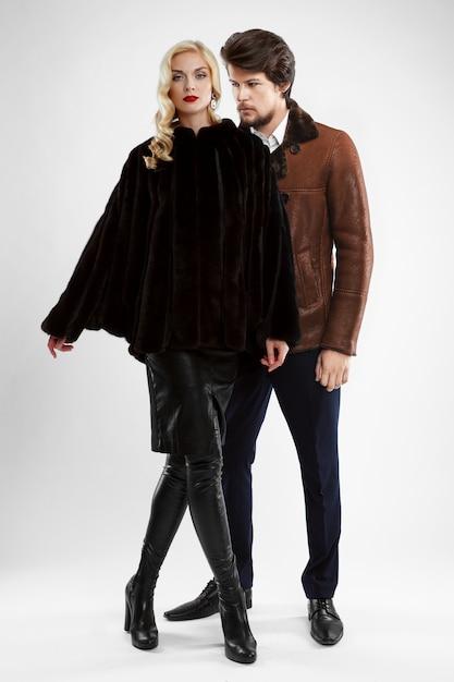 Stylish man and glamour woman in fur coat posing Premium Photo