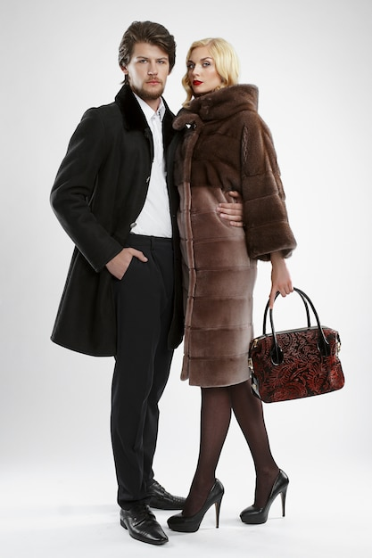 Stylish man and glamour woman in fur coat posing Premium Photo