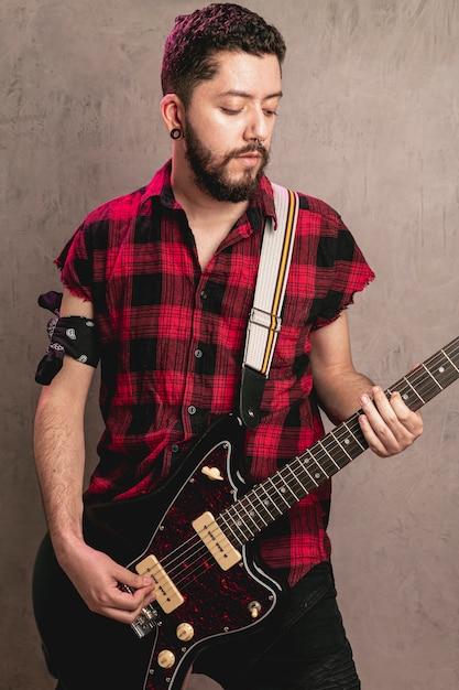 Stylish man playing beautiful old guitar Free Photo