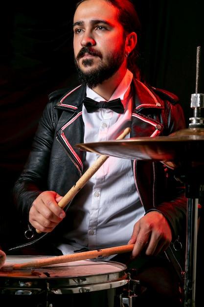 Stylish man playing on drum set Free Photo