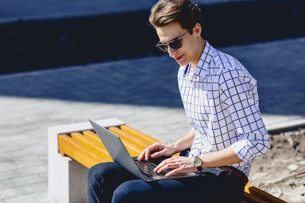 Stylish man working on laptop at street Premium Photo