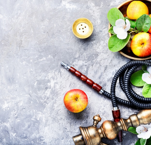 Stylish oriental shisha with apple Premium Photo