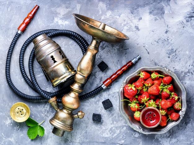 Stylish oriental shisha with strawberry Premium Photo