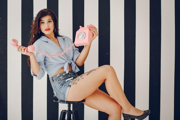 Stylish pin up girl Free Photo