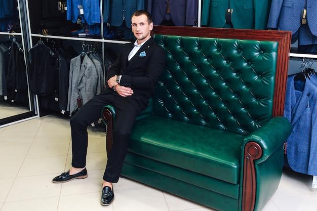 Stylish seller of men's suits Premium Photo