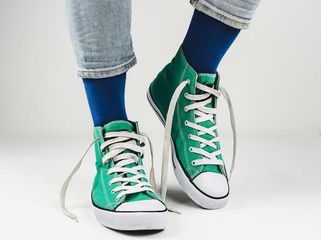 Stylish sneakers and funny, happy socks Premium Photo
