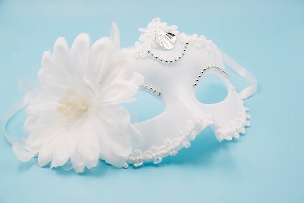 Stylish white mask with big flower Free Photo