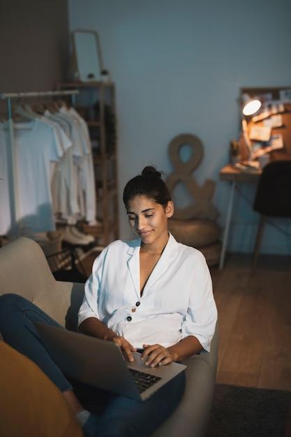 Stylish young lady working on laptop Free Photo