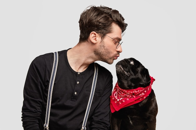 Stylish young man and his cute dog Free Photo