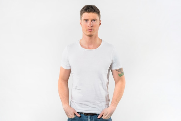 Stylish young man with his hands in pocket against white background Free Photo