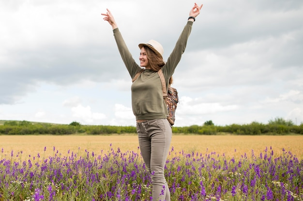 Stylish young woman enjoying holiday in the field Free Photo