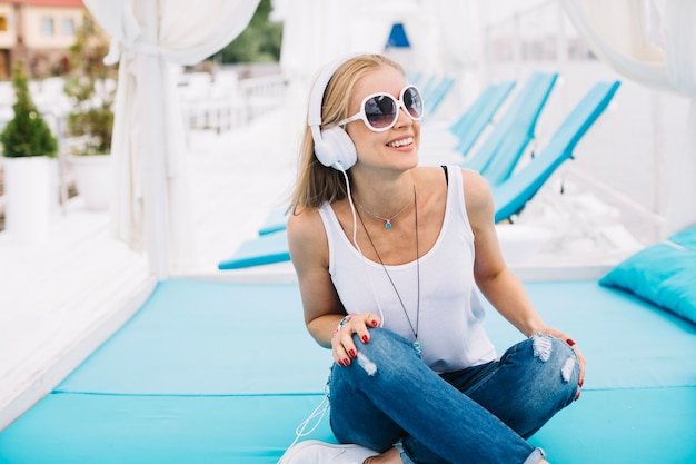 Stylish young woman relaxing with music Free Photo
