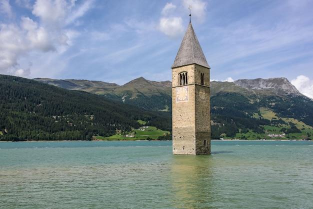 Submerged bell tower in reschensee Premium Photo