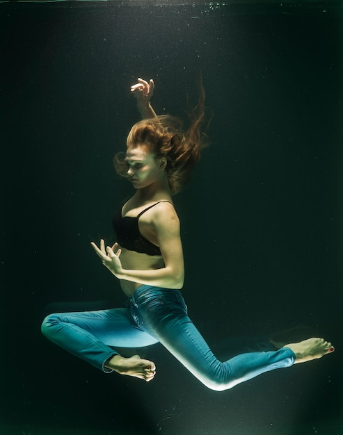 Submerged woman posing in jeans Free Photo