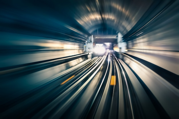 Subway tunnel with blurred light tracks with arriving train in the opposite direction Premium Photo