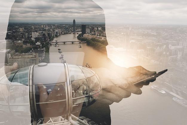 Success businessman using digital tablet with london building and social media diagram Premium Photo