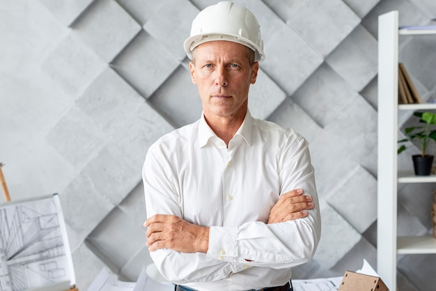 Successful architect with safety helmet Free Photo