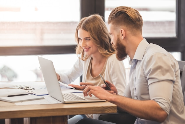Successful business couple is using a laptop Premium Photo