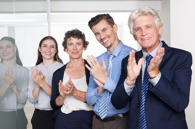 successful business people smiling and applauding photo free download