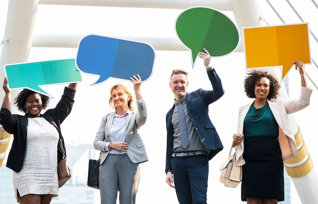 Successful business people with speech bubbles Free Photo