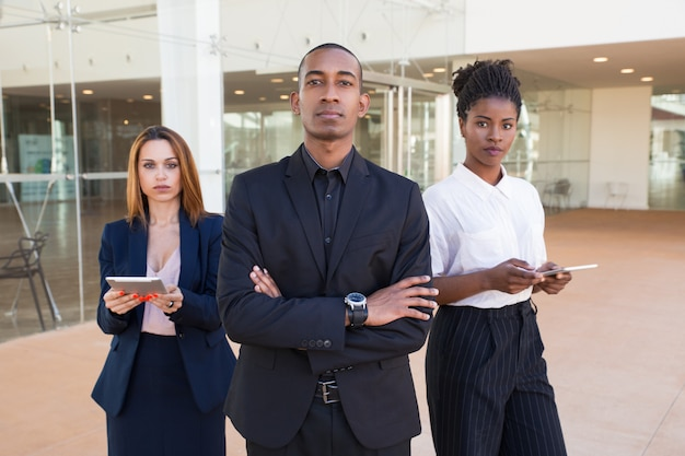 Successful business team posing in office hall Free Photo