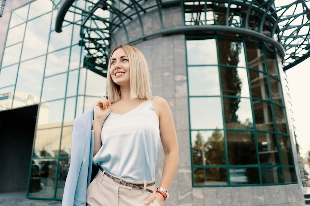 Successful business woman in blue suit Free Photo