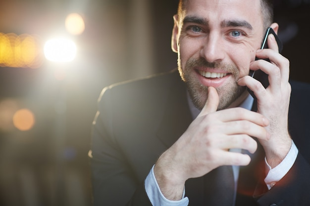 Successful businessman calling by smartphone Free Photo