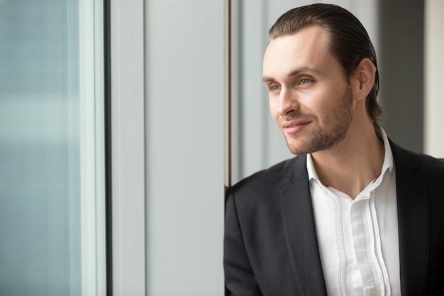 Successful businessman imagines great career Free Photo