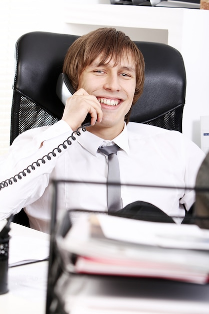 Successful businessman talking by phone Free Photo