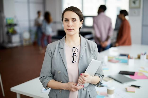 Successful businesswoman posing in office Premium Photo
