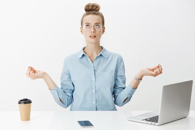 Successful female entrepreneur in blue collar shirt Free Photo