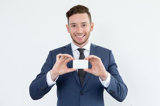 Successful financial advisor showing blank card Free Photo