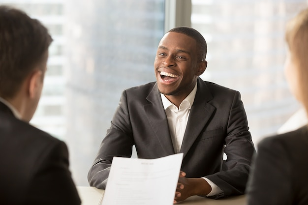 Successful happy black male candidate getting hired, got a job Free Photo