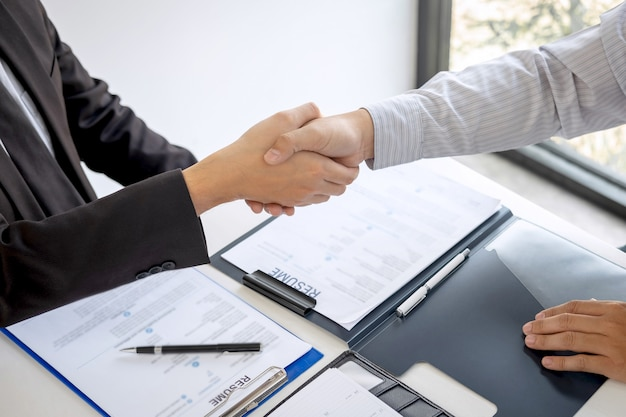 Successful job interview, boss employer in suit and new employee shaking hands after negotiation and interview, career and placement Premium Photo
