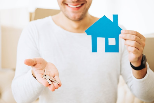 Successful man with keys from new house Free Photo