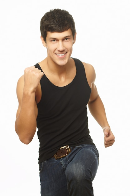 Successful muscled young man in black tanktop Free Photo