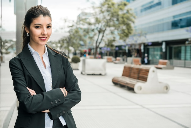 Successful smiling portrait of a young businesswoman Free Photo