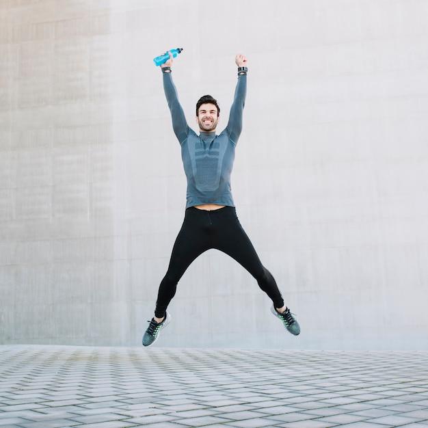 Successful sportsman jumping high Free Photo