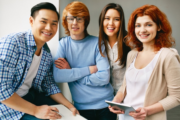 Successful teenagers prepared to work Free Photo
