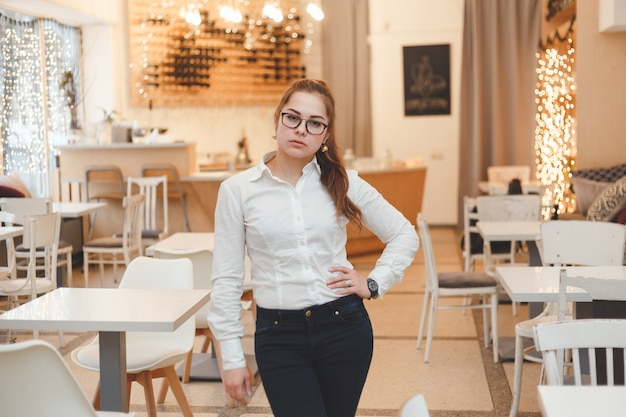 Successful woman manager at own cafe Premium Photo
