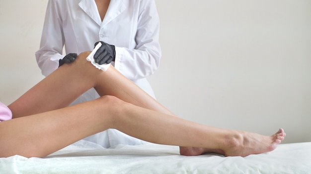 Premium Photo | Sugaring, waxing. sugar paste. professional hair removal in  the salon