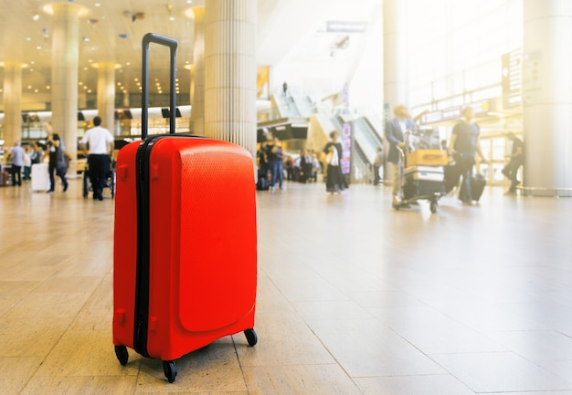 Suitcase in airport airport terminal waiting area with lounge zone Premium Photo