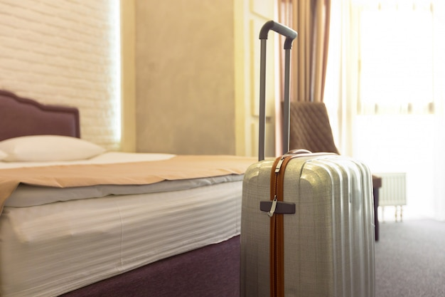 Suitcase or luggage bag in a modern hotel room Premium Photo
