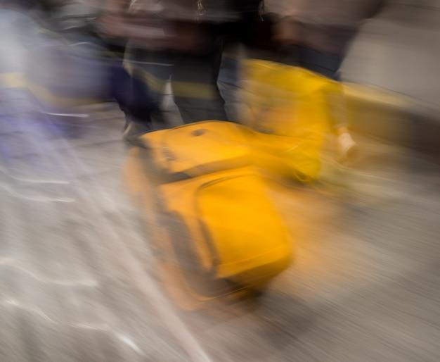 Suitcase for travel blurred Premium Photo
